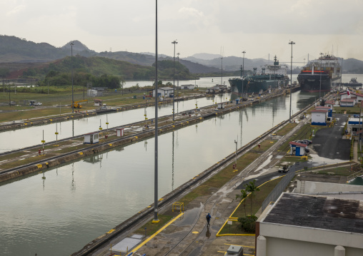 Panama, Province Of Panama, Panama City, Container Ship Passing Through The Miraflores Locks In The Panama Canal