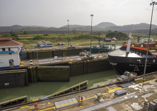 Panama, Province Of Panama, Panama City, Container Ship Passing Through The Miraflores Locks In The Panama Canal