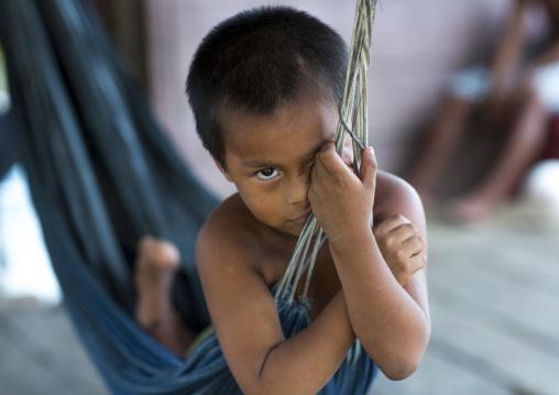Panama, Darien Province, Puerta Lara, Wounaan Tribe Boy In A Hammock
