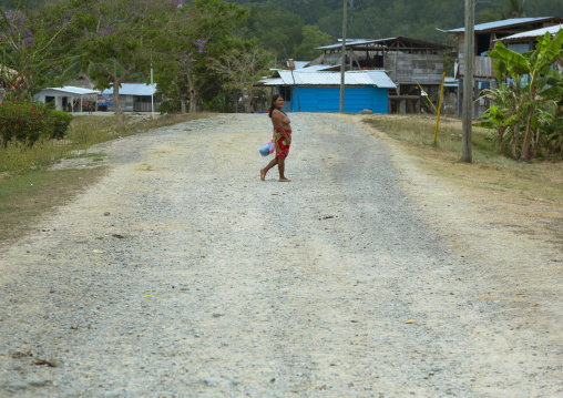 Panama, Darien Province, Puerta Lara, Wounaan Tribe Woman In The Middle Of A Road In A Village