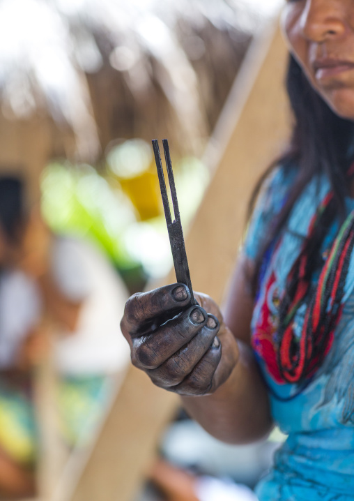 Panama, Darien Province, Bajo Chiquito, Woman Of The Native Indian Embera Showing A Stick For Jagua Bodypaint
