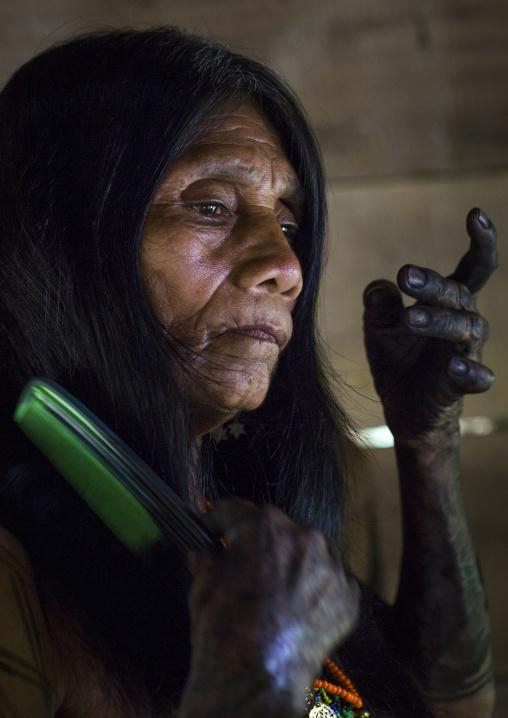 Panama, Darien Province, Bajo Chiquito, Woman Of The Native Indian Embera Tribe Combing Hair