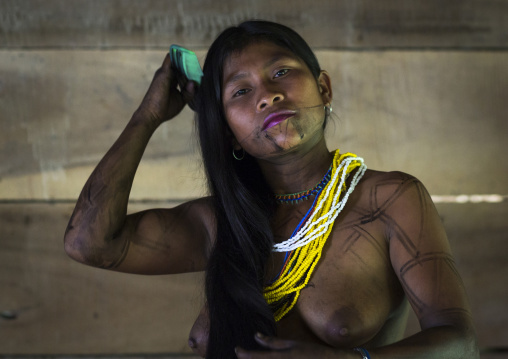 Panama, Darien Province, Bajo Chiquito, Woman Of The Native Indian Embera Tribe Combing Hair
