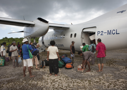 Plane arriving in airport, Milne Bay Province, Trobriand Island, Papua New Guinea