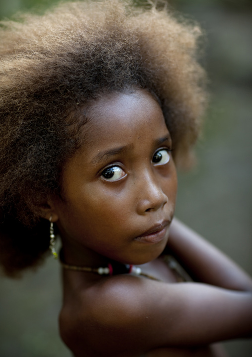 Portrait of an islander girl with blonde hair, Milne Bay Province, Trobriand Island, Papua New Guinea