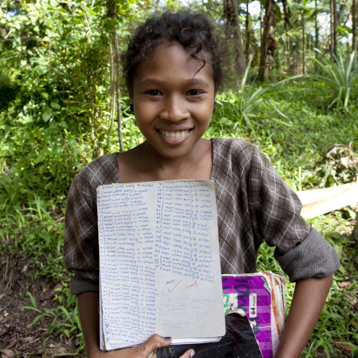 Islander girl with school works, Milne Bay Province, Trobriand Island, Papua New Guinea