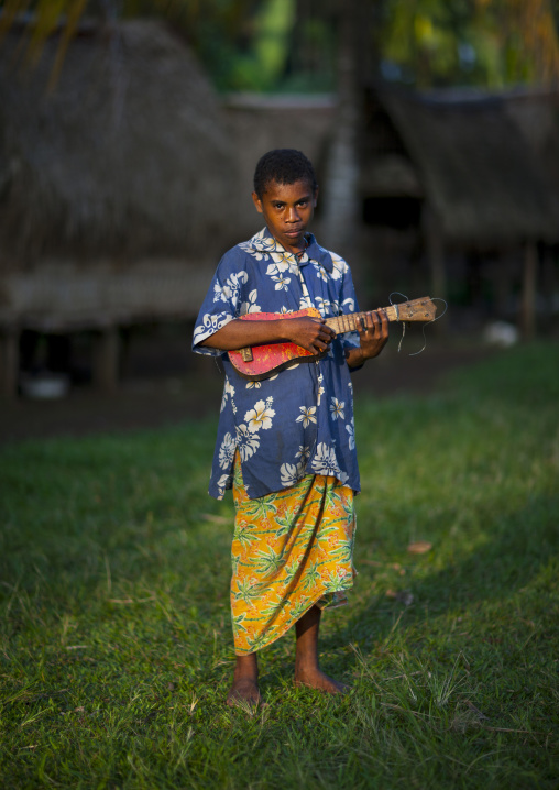 Islander girl playing guitar, Milne Bay Province, Trobriand Island, Papua New Guinea