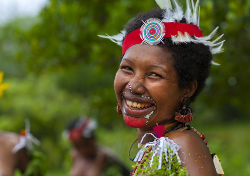 Portrait of a smiling tribal woman in traditional clothing, Milne Bay Province, Trobriand Island, Papua New Guinea