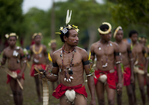 Tribal dancers in traditional clothing during a sing-sing, Milne Bay Province, Trobriand Island, Papua New Guinea