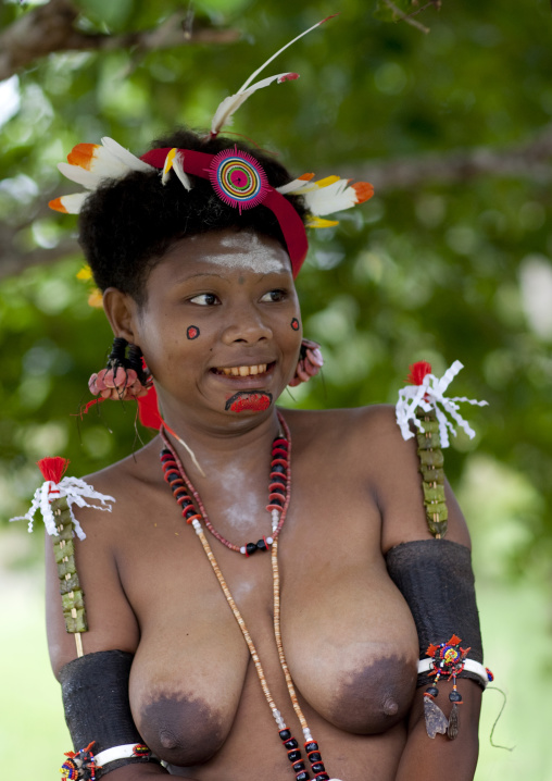 Portrait of a smiling topless tribal woman in traditional clothing, Milne Bay Province, Trobriand Island, Papua New Guinea