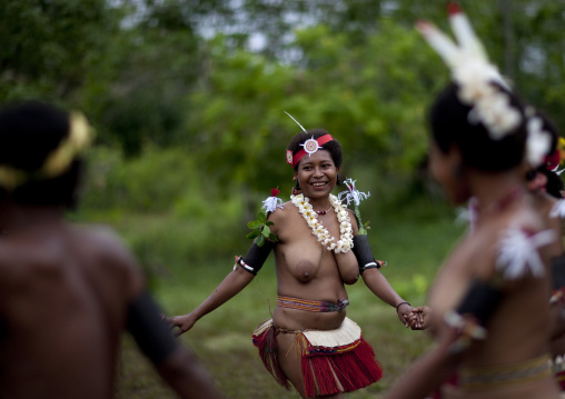 Tribal topless women dancing during a sing-sing, Milne Bay Province, Trobriand Island, Papua New Guinea
