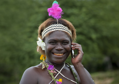 Portrait of a woman in traditional clothes calling on the phone, Autonomous Region of Bougainville, Bougainville, Papua New Guinea