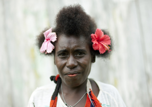 Portrait of a woman wearing flowers in the hair, Autonomous Region of Bougainville, Bougainville, Papua New Guinea