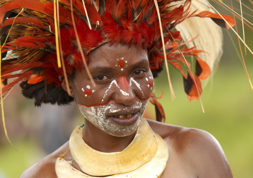 Portrait of a Chimbu tribe woman with headdress made of feathers during a Sing-sing, Western Highlands Province, Mount Hagen, Papua New Guinea