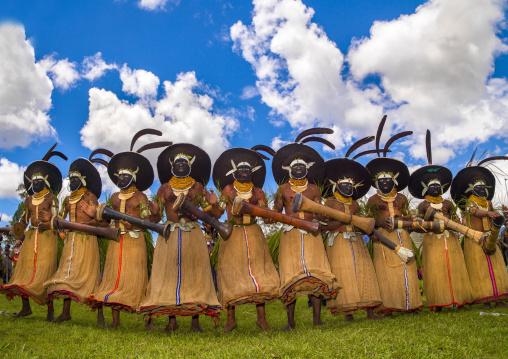 Enga kompian suli muli wigmen dancing in line during a Sing-sing, Western Highlands Province, Mount Hagen, Papua New Guinea