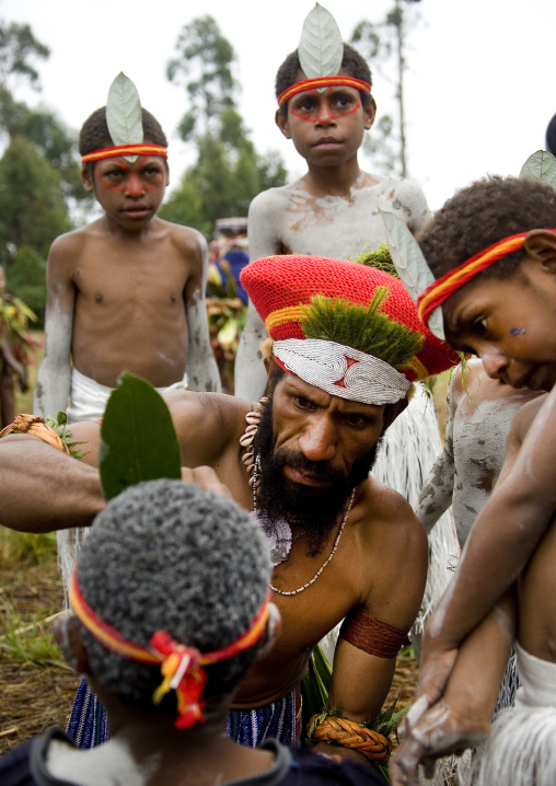 Early morning makeup for the children during a  sing sing, Western Highlands Province, Mount Hagen, Papua New Guinea