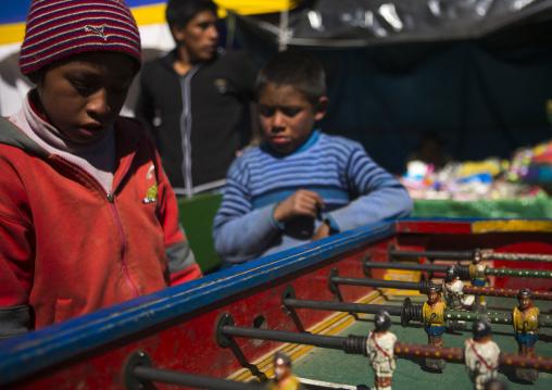 Young Peruvian Children Playing Baby Foot, Qoyllur Riti Festival, Ocongate Cuzco, Peru