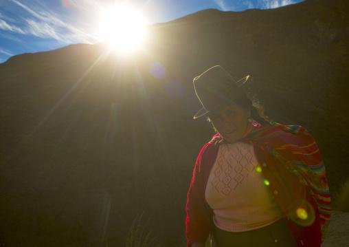 Peruvian Woman Climbing To The Qoyllur Riti Festival, Ocongate Cuzco, Peru