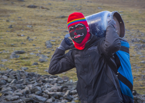 Masked Peruvian Man Climbing To The Qoyllur Riti Festival, Ocongate Cuzco, Peru