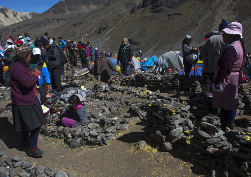 Family By Small Stone Houses And Plots Of Land After Challa, Qoyllur Riti Festival, Ocongate Cuzco, Peru