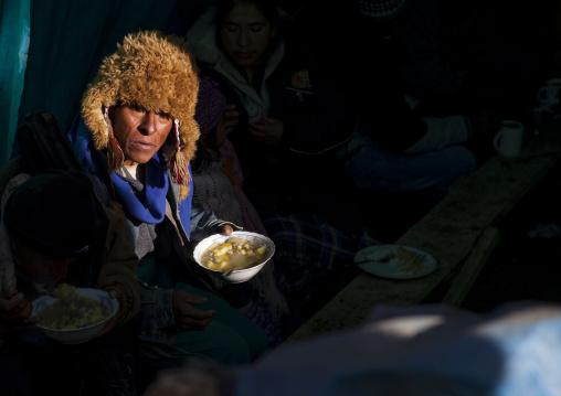 Peruvian Man Eating During The Qoyllur Riti Festival, Cuzco, Peru