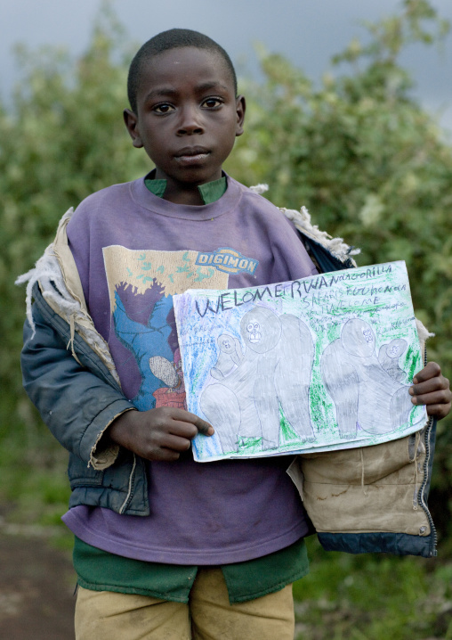 Rwandan boy showing his gorilla drawing in volcanoes national park area, Lake Kivu, Ibwiwachu, Rwanda