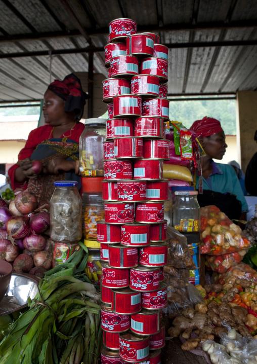Tomatoes cans for sale in the market, Lake Kivu, Gisenye, Rwanda