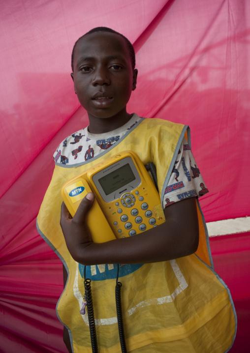 Rwandan man with a mtn phone in the market, Lake Kivu, Gisenye, Rwanda