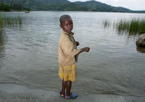 Rwandan boy fishing, Lake Kivu, Gisenye, Rwanda