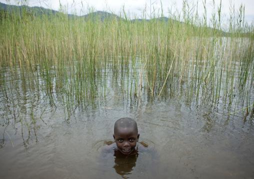 Kid in lake kivu , Gisenye village - rwanda
