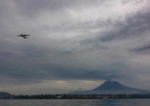 Plane taking off in front of nyiragongo congo volcano, Lake Kivu, Gisenye, Rwanda
