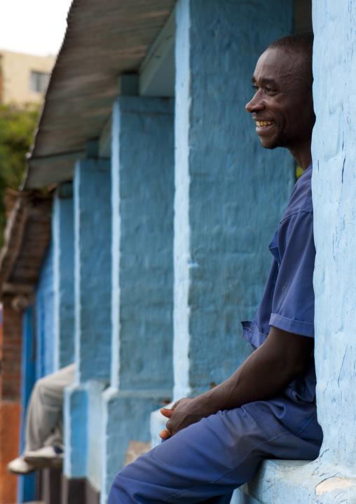 Rwandan man sit on a house balcony, Western Province, Karongi, Rwanda