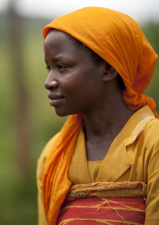 Rwandan woman in ornage clothes, Lake Kivu, Nkombo, Rwanda