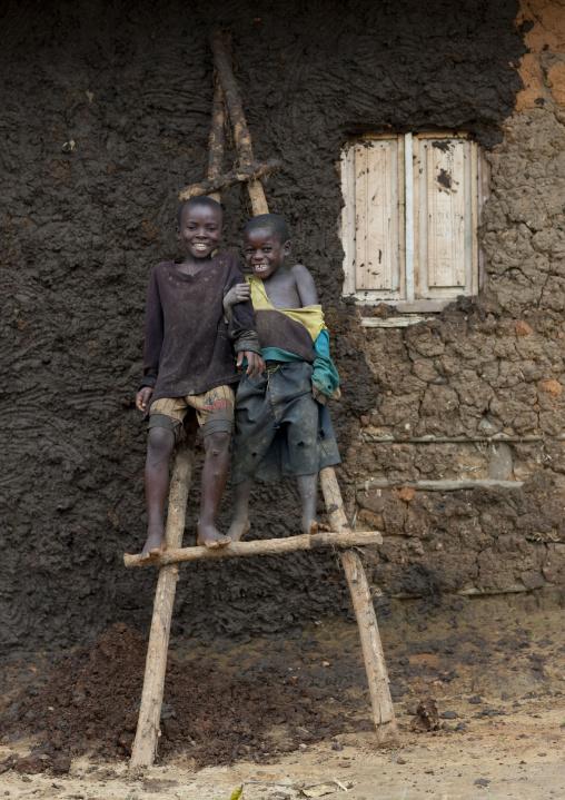 Batwa tribe boys on a ladder, Western Province, Cyamudongo, Rwanda