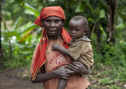 Batwa tribe mother holding her child, Western Province, Cyamudongo, Rwanda