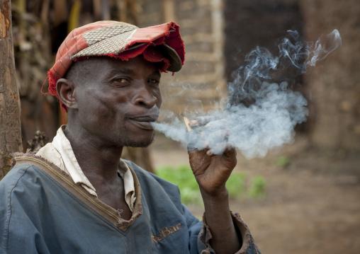 Batwa tribe man smoking, Western Province, Cyamudongo, Rwanda