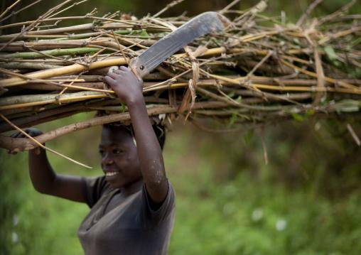 Batwa tribe woman carrying wood on her head, Western Province, Cyamudongo, Rwanda