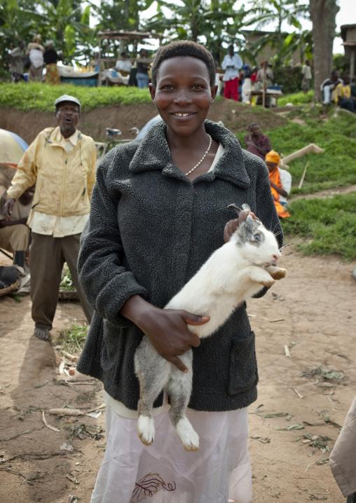 Rwandan woman selling a rabbit in a market, Kigali Province, Kigali, Rwanda
