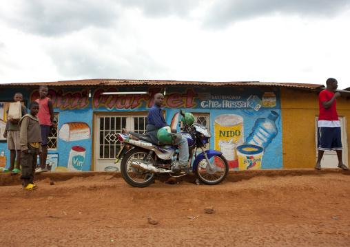 Rwandan people in front of a shop mural, Kigali Province, Kigali, Rwanda