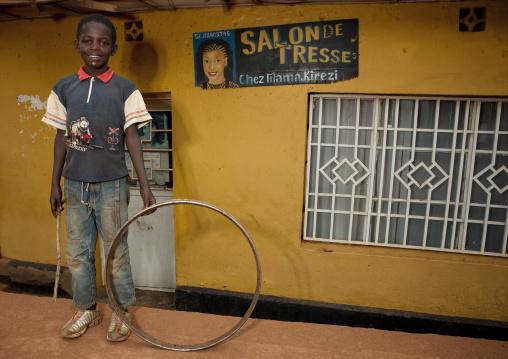 Rwandan boy playing n the street, Kigali Province, Kigali, Rwanda