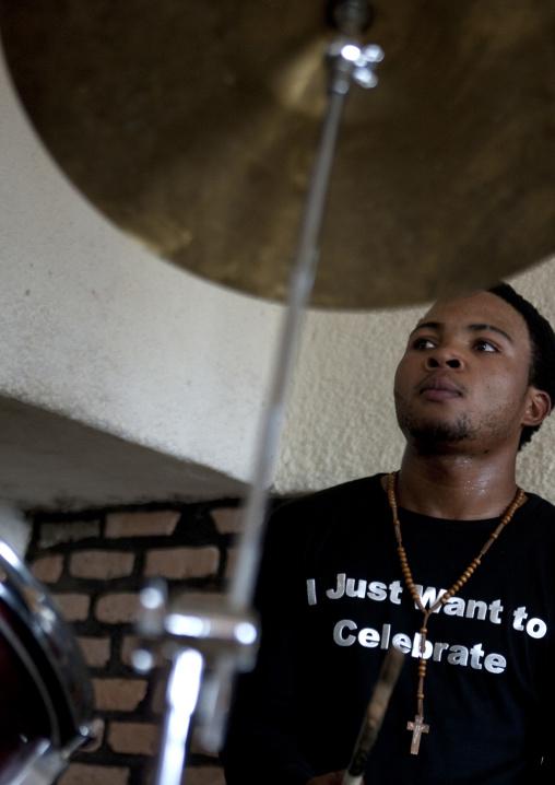 Rwandan man playing drums during a sunday mass in a church, Kigali Province, Kigali, Rwanda