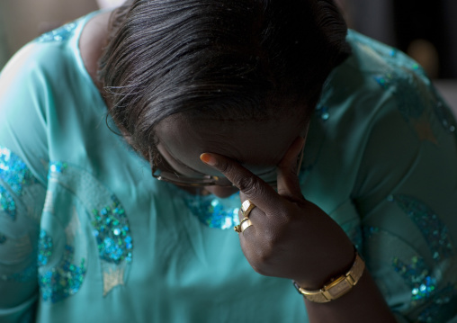 Rwandan woman praying during a sunday mass in a church, Kigali Province, Kigali, Rwanda