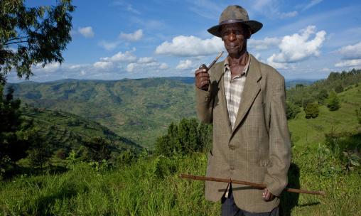 Rwandan old man smoking pipe, Kigali Province, Kigali, Rwanda