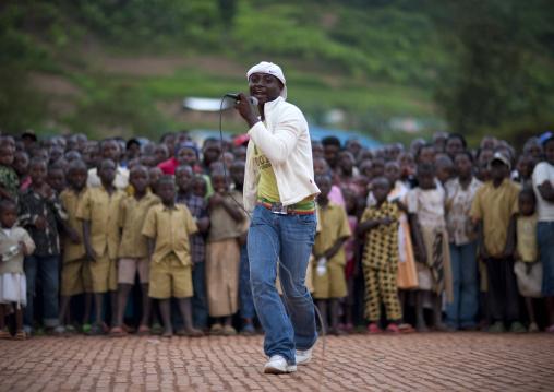 Rwandan hip hop singer performing in a village, Kigali Province, Nyirangarama, Rwanda