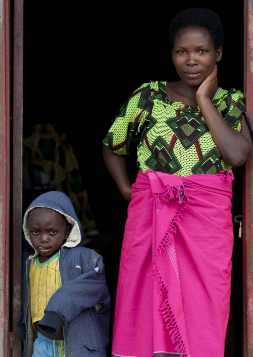 Rwandan mother and kid in front of their house, Northwest Province, Rehengeri, Rwanda