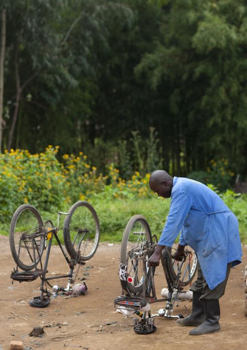 Man repairing a bike , Rwanda