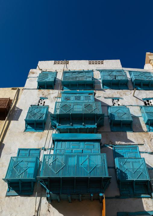 Historic house with blue wooden mashrabiyas in al-Balad quarter, Mecca province, Jeddah, Saudi Arabia