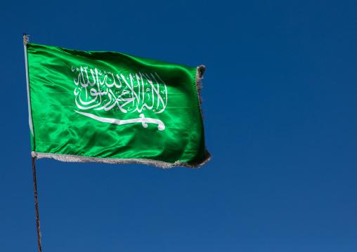 Saudi arabian flag in the wind against clear sky, Al Madinah Province, Yanbu, Saudi Arabia