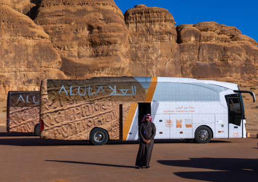 Tourists buses in Madain Saleh archaeological site, Al Madinah Province, Alula, Saudi Arabia
