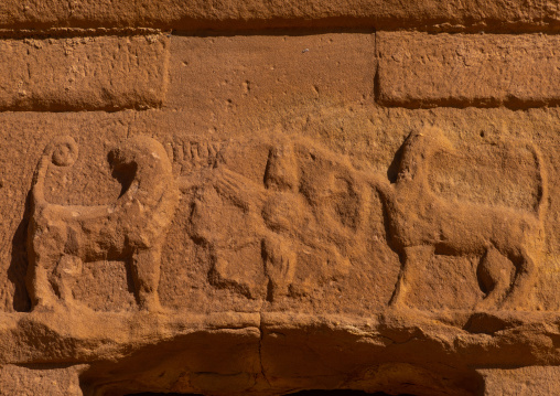 Rosette and lions carved on a tomb in al-Hijr archaeological site in Madain Saleh, Al Madinah Province, Alula, Saudi Arabia